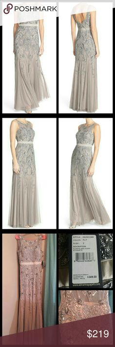 Adrianna Papell Embellished Sleeveless Mesh Gown NEW WITH TAGS Adrianna Papell Embellished Sleeveless Mesh gown. Smokey taupe in color. Mesh overlay bodice with flowing godets and sequins. Back zip closure with jewel neckline.  Fully lined and padded cups in the bust. Size 2. New with tags and never worn. Perfect condition for your special occasion. Retail is $349.  Reasonable offers encouraged or bundle and save. Adrianna Papell Dresses