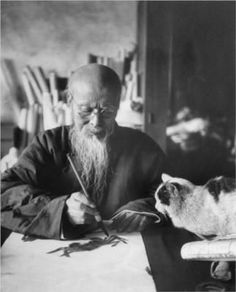 Qi Baishi (1864-1957), painter, with his Cat.