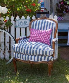 Striped chair + pink pillow.