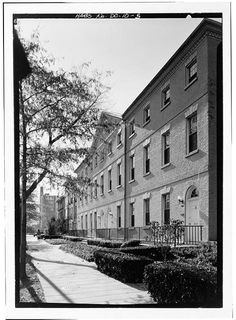 Looking Back: Wheat Row: DCist Wheat Row, constructed in 1794, is the city's oldest standing group of rowhouses. Located in Southwest near the waterfront on 1315 through 1321 4th Street SW, the Federal-style cluster are designed to appear as a single structure. Named after a resident and Senate messenger, John Wheat, these rowhouses are one of the few remaining pre-1950 buildings to survive the massive urban renewal the government undertook on the neighborhood. Jan 1972 Boucher photog