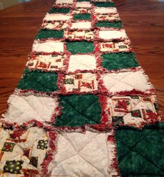 Christmas Rag Table Runner  with soft red flannel on back  colors red,cream,and green  size 16 x 60    $25.00.