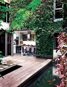 A glass-walled Umhlanga, KwaZulu-Natal family home is characterised by space, sunshine and serenity – and a beautiful vertical garden. By Brendon Edwards Landscapes & Stefan Antoni Olmesdahl Architects.