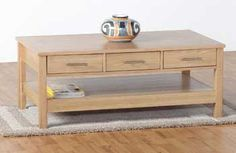 Furniture123 Oakleigh 3 Drawer Coffee Table  If the space in the middle of your living room looks a bit bare, the obvious answer is a coffee  http://www.comparestoreprices.co.uk/coffee-tables/furniture123-oakleigh-3-drawer-coffee-table.asp