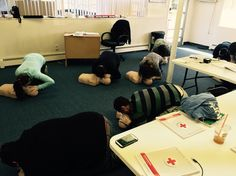 CPR students giving rescue breaths