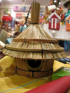 Tropical beach-hut homes for birds in store, pity we don't sell human sized ones!