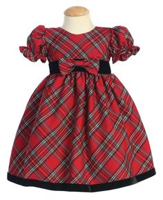 Ring in the festivities in this super adorable plaid dress. The waist features the cutest three dimensional bow and the sleeves have a cute ruffled accent, $45.99