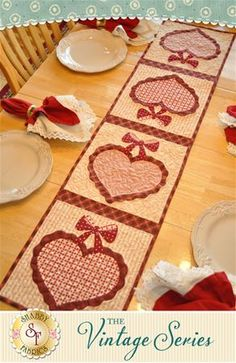 Vintage Blessings Table Runner Kit - February: Decorate your home all year long with a beautiful Vintage Blessings Table Runner by Jennifer Bosworth of Shabby Fabrics. This applique kit is for the February design. Table Runner measures approximately x Table Runner And Placemats, Table Runner Pattern, Quilted Table Runners, Valentine Decorations, Valentine Crafts, Valentines, Quilted Table Toppers, Shabby Fabrics, Tablerunners