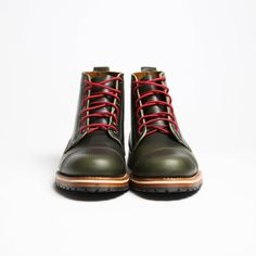 green boots for men, men's green army boots, red laces, weathered coalition Our Austin, Texas neighbors and friends - the fellas at HELM Boots know a thing or two about quality footwear. The Marion in Olive from HELM is a blucher boot that is perfect for everyday wear. This boot features a chromexcel upper, a mini-lug for extra durability, Blake Rapid stitching, and is fully lined in natural calfskin. The boot also comes with black or red laces