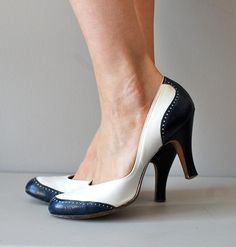 Deauville heels  vintage 1940s, early 1950s white leather heels with navy blue leather spectator toe and navy blue heel. very round toe and leather insole.