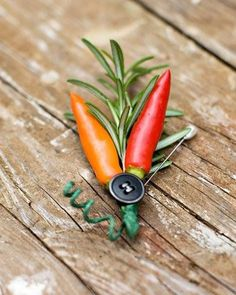 The groomsman's mother made all of the boutonnieres (and the bridal bouquet) from flowers and vegetables bought at the local farmer's market. Made from peppers and rosemary, the edible ingredients were perfect for a chef to wear on his wedding day. They are fastened with antique buttons, similar to those used on the invitations. Buy at your local market or #GrowYourOwnWedding