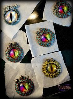 Creation process of Dragon Eyes Pendants - here the unfired / unbaked pieces! Some Dragoneye pieces are available at the Shop! :) Creative studio - peak behind scenes of ChaNoJa Artist Studio - work in progress - handmade jewelry - clay art - polymer clay jewelry - eye pendants.