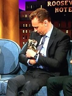 This just in: Tom Hiddleston holding a clouded leopard cub.