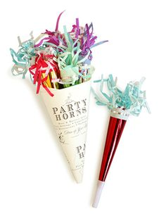 Party horns at each table to blow during reception intros or during your grand exit at the end of the night?  (Could be fun!)
