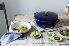 Our exclusive Staub has a deep blue exterior and pops of brass on the handles.
