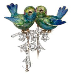 An 18 karat gold, enamel and diamond brooch of love birds by Boucheron. The brooch features two green and blue enamel love birds with ruby eyes. The birds are perched on a branch studded with 51 baguette, full and single cut diamonds. Signed Boucheron, Paris, #16532 with French assay marks.