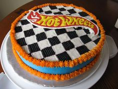 "Hot Wheels Checkerboard 10"" round cake, buttercream icing and checkerboard (took forever) and a royal icing color flow hot wheels logo..."