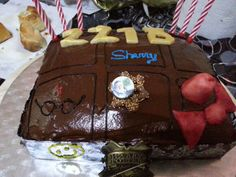 A totally fandom cake. Sharlock, Dr . Who, Harry Potter and even Loky!