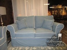 "Slip-covered loveseat in a super appealing, soft blue fabric with bright white welting. Ideal for a coastal style home! Nice size too. Measures 52""long x 36""deep x 40""high. At posting, we have the matching sofa."