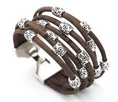 Cork Bracelet - seven strand dark cork with sterling silver beads via boutiika.com $69 via www.boutiika.com