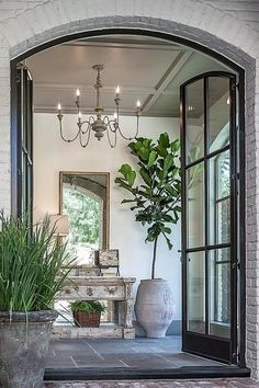 steel french doors leading to gracious entry hall Design Entrée, House Design, Hall Design, Design Trends, Design Ideas, Foyer Design, Garden Design, Lobby Design, Design Inspiration