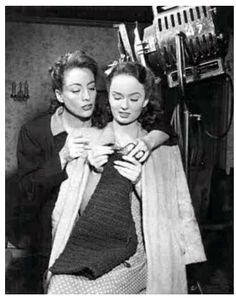Joan Crawford helps out Ann Blythe, who played her scheming daughter in Mildred Pierce.