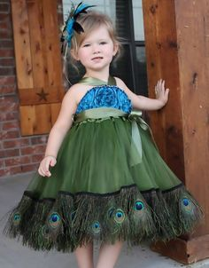This would be a totally adorable flower girl dress in a wedding that incorporates the peacock feather.
