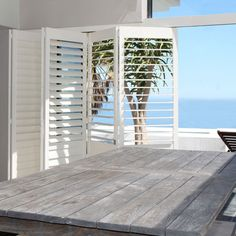 Woodlore and Woodlore Plus Shutters are the perfect option for coastal inspired interiors. If you're looking for custom-crafted quality window furnishings, with timeless durability and design, and the latest smart technology — meet Norman Australia, leading in innovation and excellence of window furnishings for Australians.  Get in contact with your local Retail Partner today! Coastal Homes, Coastal Living, Outdoor Rooms, Outdoor Living Areas, Home Interior Design, Exterior Design, Future House, My House, Hamptons Style Homes