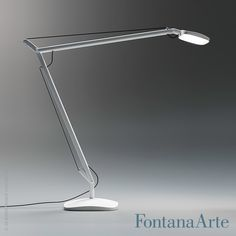 A touch sensor over the head allows the flow of light to be regulated to 4 different levels of intensity, Volee Desk Lamp. #fontanaarte #desklamp #tablelamp #odofioravanti  Available at allmodernoutlet.com  http://www.allmodernoutlet.com/fontanaarte-volee-desk-lamp/