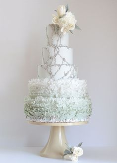 From ruffle detailing to crystal embellishment, the beautiful details of this wedding cake couldn't be any sweeter. #wedding #bridal #cakes