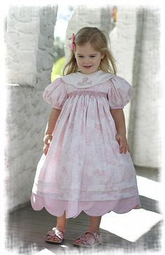 Beatrix Potter Toile Smocked Dress.   I love seeing dresses modelled on little girls, and love the toile fabric.