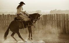Cowgirl working a Bucking Horse