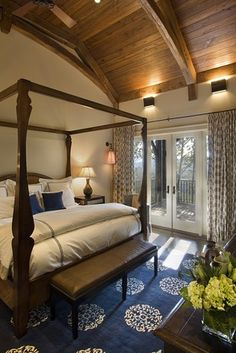 beautiful bedroom with wood plank ceiling