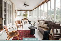 When updating an 1881 Victorian country house in St. Helena, California, Katie Martinez sought out antiques, mid-century pieces and bold designs that would enhance the home's historic character and overall charm. To achieve that in the light-drenched sunroom, with its wraparound windows and views of the property's lush surroundings, Martinez combined the clients' own furnishings with new and vintage finds, such as a rug purchased at a flea market, a side table made from tires and armchairs…