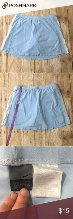 Light blue Nike tennis skirt Light blue tennis skirt with mesh detail on sides built in under garmets like all tennis skirts, light wear no stains or tearing good used condition - bundle and save! Nike Skirts