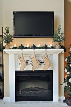 Beautiful simple Christmas mantel with burlap stockings!