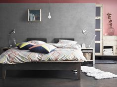Modern bedroom design with NORNÄS bed in grey, bedside table and wardrobe in untreated pine, plus IKEA PS 2014 bed linen