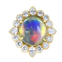 Jelly Opal and Diamond Ring consisting of 1 oval shaped cabochon jelly opal weighing 6.32 carats, the center stone is set with 2.03 carats of round brilliant cut and pear shape diamond diamonds.