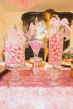 Candy jars at a pink and gold baby shower party! See more party planning ideas at CatchMyParty.com!