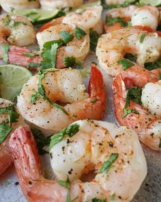 Clean Eating Cilantro-Lime Shrimp  2 pounds large raw shrimp, deveined, shells removed 4 Tbsps high quality olive oil, melted unrefined coconut oil (melt in a saucepan), or avocado oil 1 bunch fresh cilantro leaves, chopped 1 tsp sea salt, & freshly groun