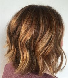 We love this blend of brunette and copper red hair color by stylist Erin Stoner. It's the perfect combination for a short haircut with layers.