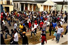 A second line featuring, The Stooges Brass Band, travels through the streets of New Orleans.