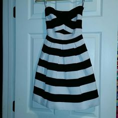 Express NWOT Fit & Flare dress XS So cute!!! Brand new without tags, elastic stripe fit and flare dress, size XS no longer being sold! Colors are black and white with a very flattering silhouette  Smoke and pet free home, please feel free to ask questions, or request additional photos  Don't forget to bundle for discounts! Express Dresses Mini