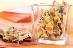 Howling Candy Corn Cookie Bark recipe - so cute!  I would leave out the raisins too!