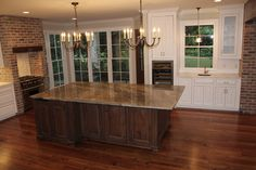 Island was designed to read like a piece of furniture. It is granite while surrounding counter tops are white marble.