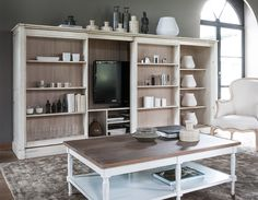 Grange hidden TV cabinet inside shelving wall unit.