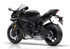 Yamaha states that the 2018 comes with MotoGP technology, a cross-plane engine, short wheelbase chassis and high-tech electronics. Yamaha Motorcycles, Yamaha Yzf R1, Cars And Motorcycles, Motogp, Photo Galleries, Bike, Gallery, Vehicles, Pictures