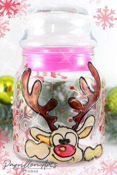 Hand-painted glass jar with cute reindeer.