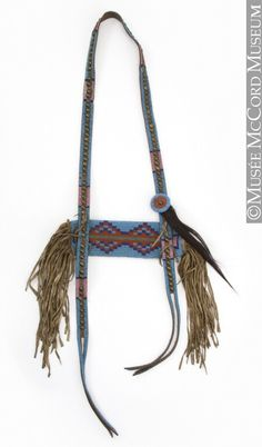 Telescope case, Northern Plains. 1870-1920, 19th century or 20th century. Leather, tanned and smoked hide, glass beads, brass tacks and button, hair, sinew, cotton thread, pigment. 91 x 75 cm. Gift of Hayter Reed. ME931.1.3.1-3 © McCord Museum