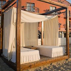 put rods at both the tops and bottoms of outdoor curtains to keep the wind at bay