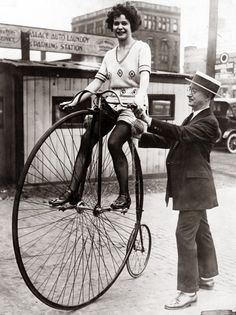 A woman on a Victorian-era bicycle on July 17, 1922 in Chicago. — Chicago Tribune historical photo